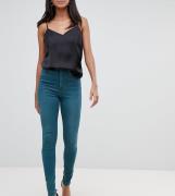 Vaqueros ajustados de tiro alto en color verde Ridley de ASOS DESIGN T...