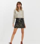 Falda de cuero sintético negro con diseño de jacquard y bolsillos de p...