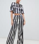 Pantalones con pernera ancha de satén metalizado con diseño multicolor...