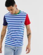 Camiseta colour block en azul/blanco con bolsillo y logo de jugador de...