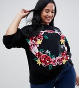 Jersey con bordado de corona floral de ASOS DESIGN Curve
