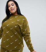 Sudadera caqui con logo metalizado repetido de Nike Plus